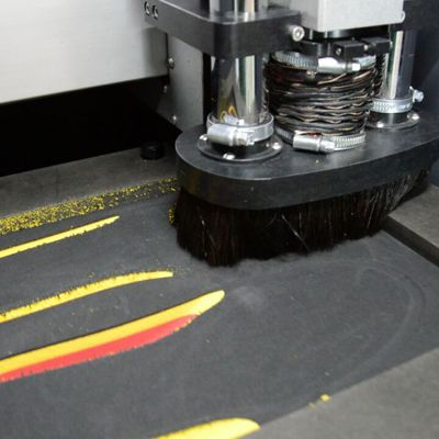 Pedorthic insoles being manufactured on a machine